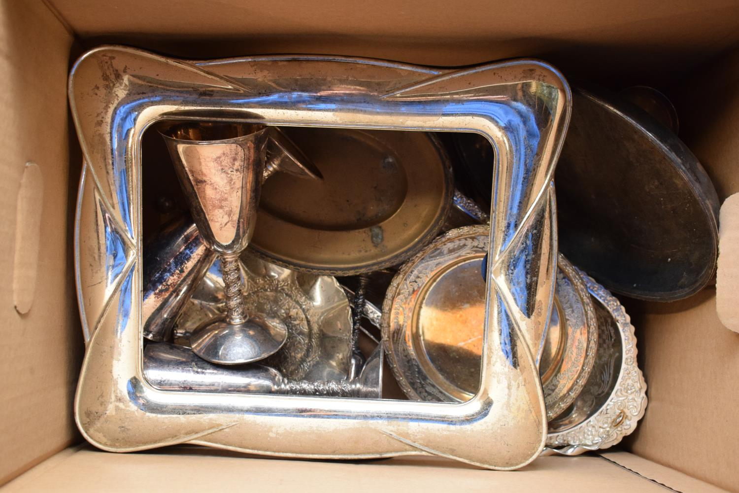 A collection of metal ware and silver plate to include goblets, bowls, large frame etc