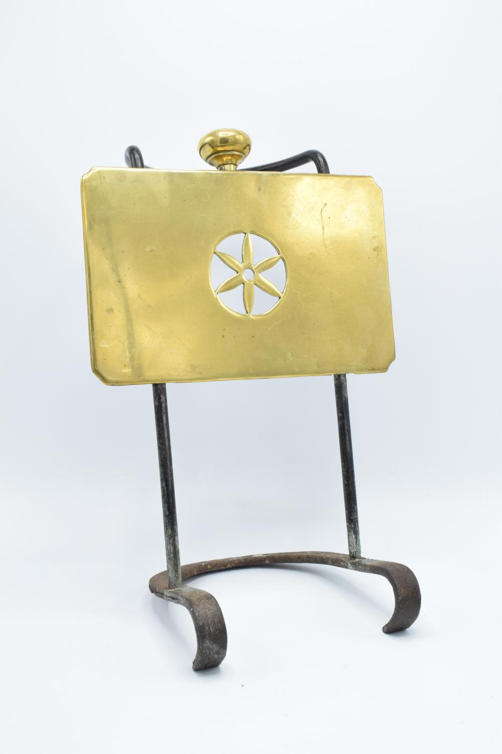 Late Victorian cast iron and brass kettle/ teapot stand for an open fire/ range
