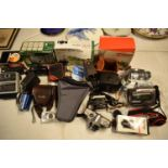 A mixed collection of cameras and accessories to include Kodak, Canon, JVC etc Condition is mixed.