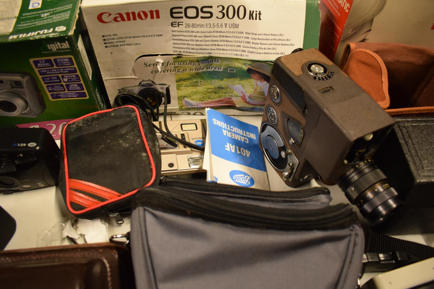 A mixed collection of cameras and accessories to include Kodak, Canon, JVC etc Condition is mixed. - Image 6 of 7