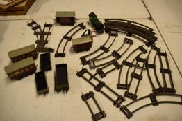 A collection of Hornby (Meccano Ltd) model trains, carriages and track (well used) All in bad and