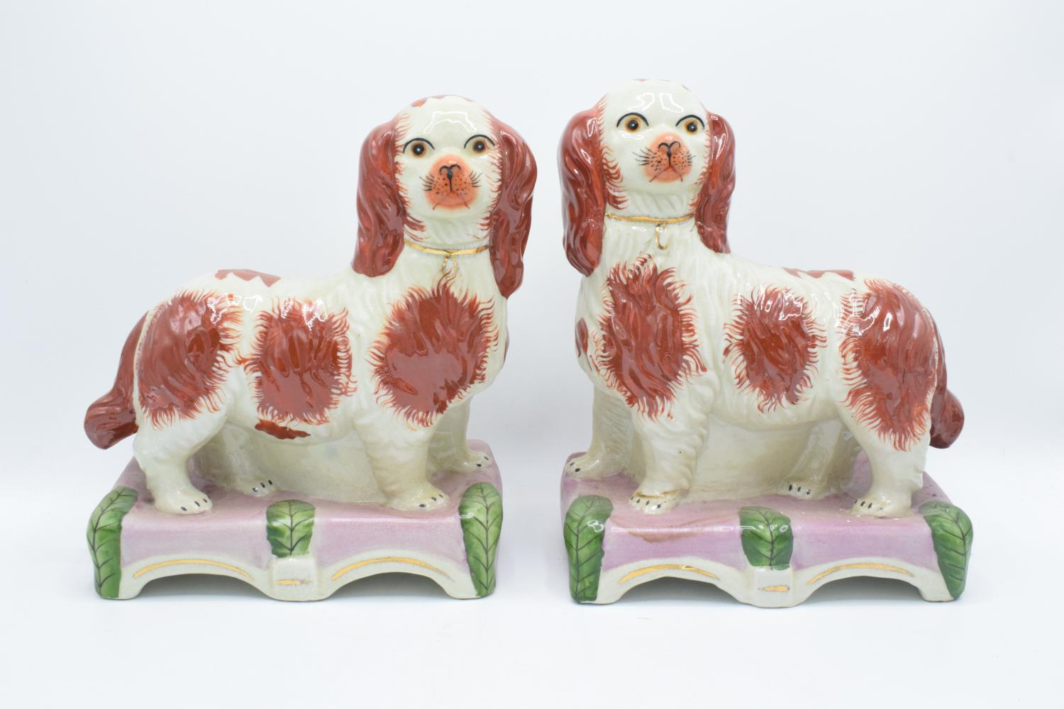 Pair of 20th century reproduction Staffordshire dogs on domed bases (2) In good condition with no