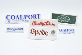 A collection of pottery point of sales to include Coalport, Carlton Ware, Wedgwood, Spode,