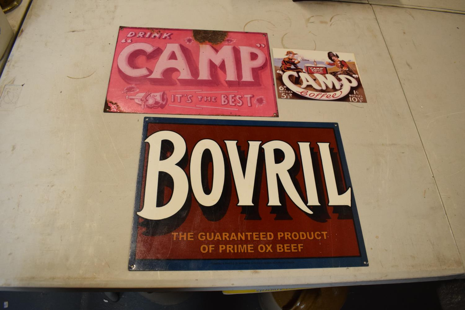 A collection of metal advertising signs including Bovril and 2 Camp (3) Rust and wear to the pink