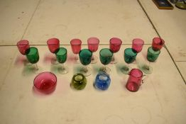 A collection of various coloured 20th glass to include wine glasses of different sizes, bowls etc (