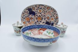 A collection of oriental items to include an oval platter and 2 lidded pots (3) all a/f together