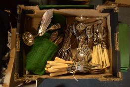 A large collection of steel and silver plate cutlery