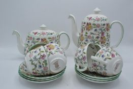 A collection of Minton Haddon Hall items to include tea and coffee pots, 6 cups and saucers and a