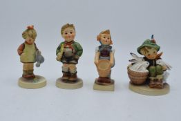 A collection of Hummel and Goebel child figures (4). In good condition with no obvious damage or