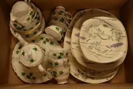 A mixed collection of tea ware to include Colclough in a green lily design to include a teapot, milk