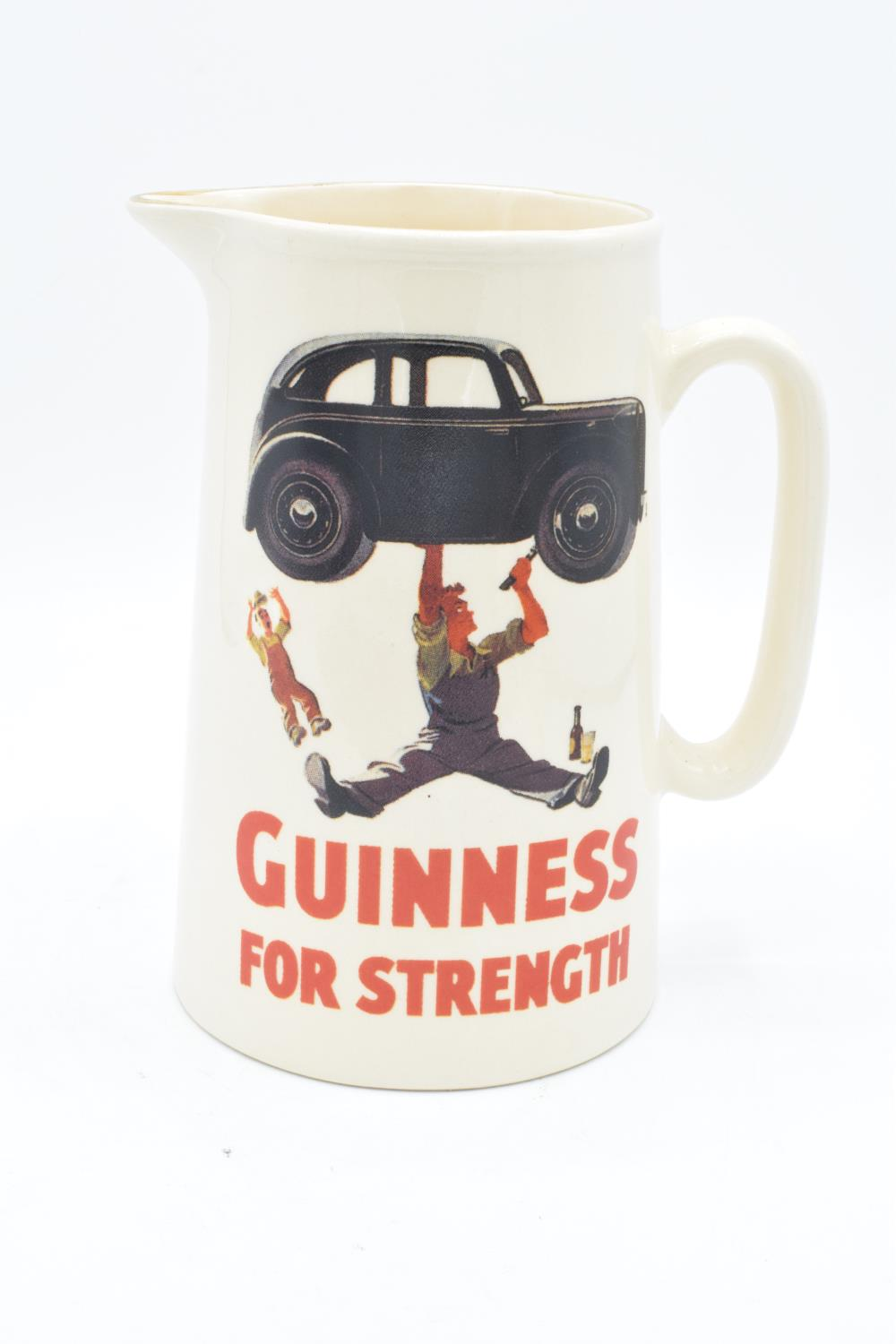 Guinness pub advertising jug 'Guinness for Strength'. In good condition with no obvious damage or