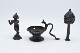 A collection of antique Oriental/ Asian bronze items to include a lamp, a figure of a goddess and an