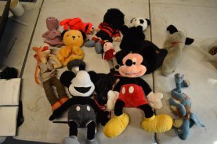A collection of cuddly toys to include Dennis the Menace, Star Wars, Mickey Mouse etc.