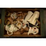 A mixed collection of items to include a Doulton Pope figure (af), tea pots, stoneware etc.