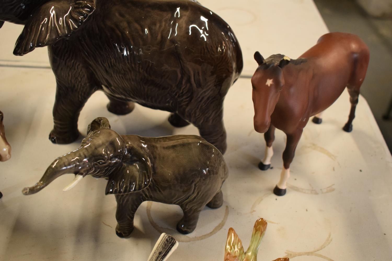 A collection of mainly Beswick animals to include elephants, a bull, birds and horses etc (all as - Image 4 of 10