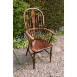 A 19th century Windsor farmhouse armchair. In good condition with age related wear and tear to