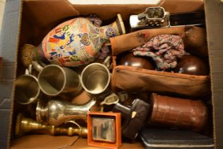 A mixed collection of items to include a pair of lawn bowls, brass candlesticks, tankards, 20th