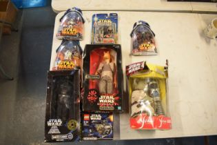 A good collection of Star Wars toys to include Jar Jar Binks, interactive Yoda, Dark Vador from