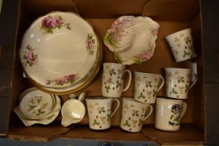 A mixed collection of pottery include Wedgwood Wild Strawberry, Royal Doulton Royal Gold plates,
