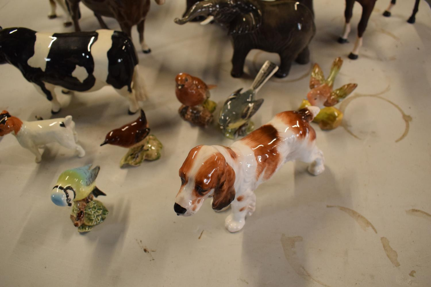 A collection of mainly Beswick animals to include elephants, a bull, birds and horses etc (all as - Image 10 of 10