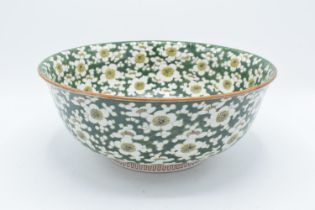 A large late 19th/ early 20th century Japanese thick porcelain bowl with a floral green design.