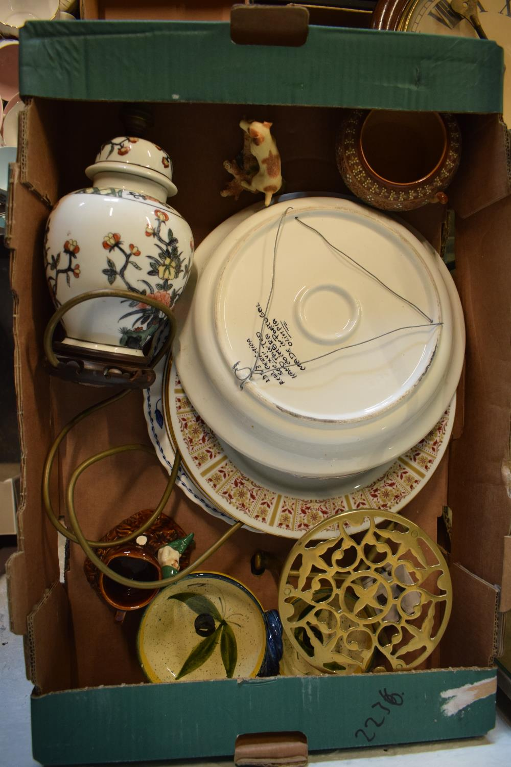 A mixed collection of items to include a brass trivet, a lamp base, Sylvac etc. Condition is