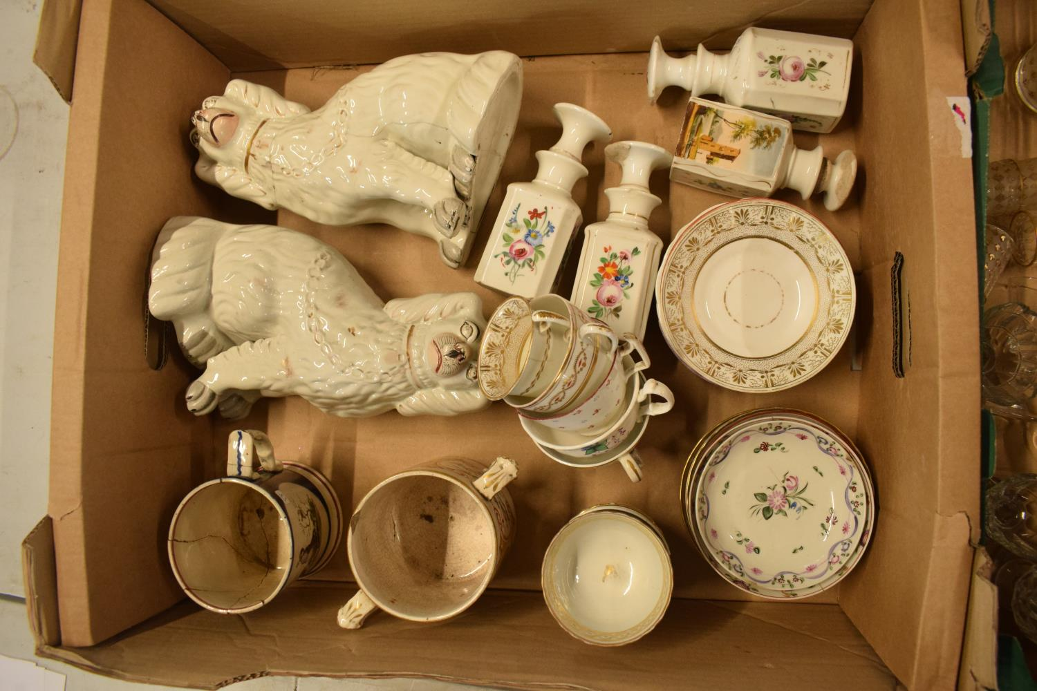 A collection of 19th century pottery to include Staffordshire dogs, tankards, opaque bottles etc. No