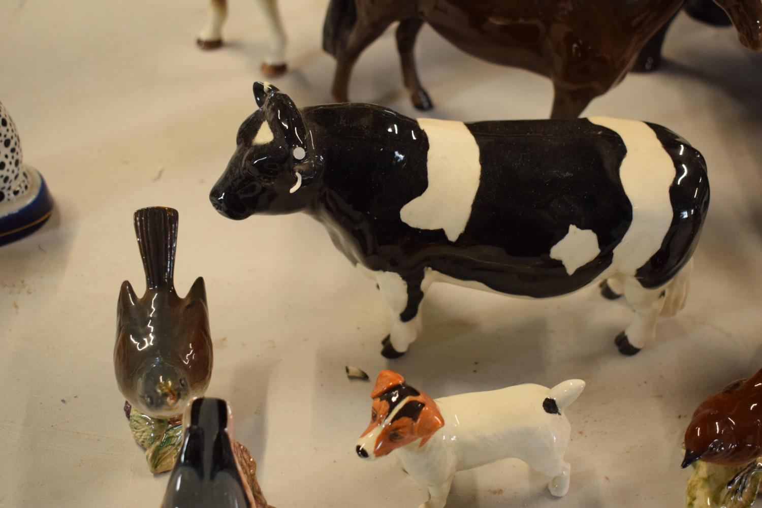 A collection of mainly Beswick animals to include elephants, a bull, birds and horses etc (all as - Image 8 of 10