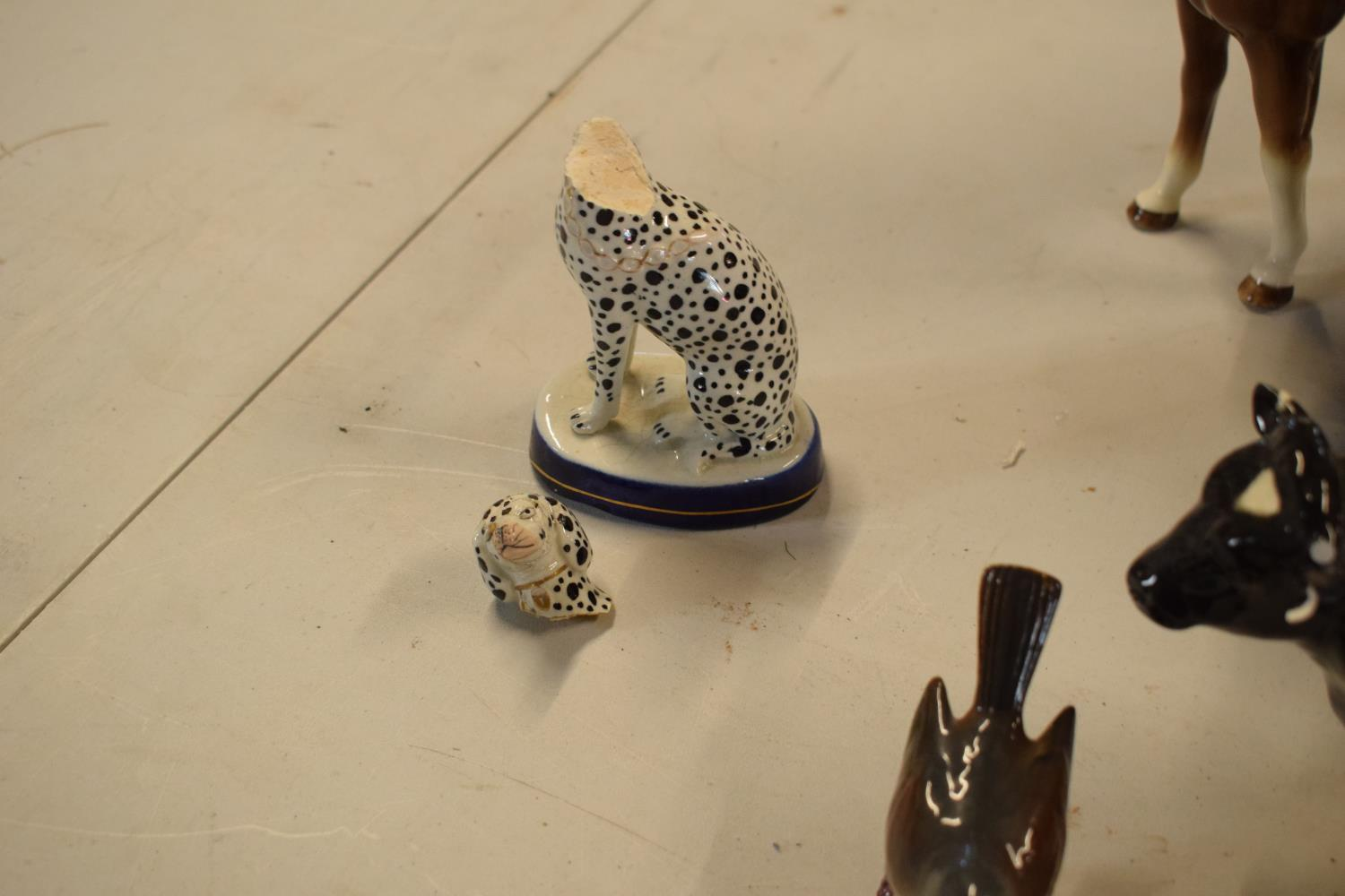 A collection of mainly Beswick animals to include elephants, a bull, birds and horses etc (all as - Image 7 of 10