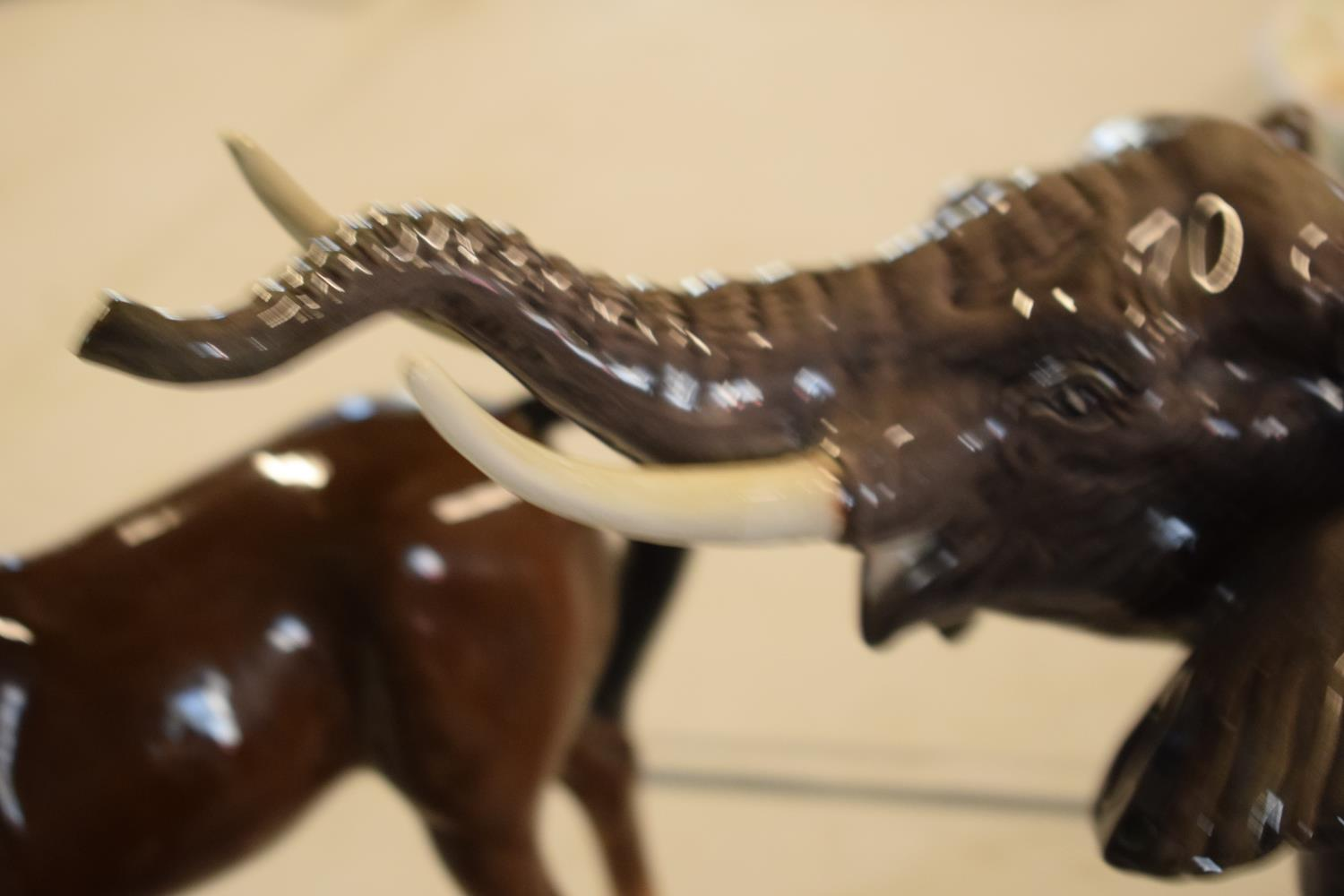 A collection of mainly Beswick animals to include elephants, a bull, birds and horses etc (all as - Image 3 of 10