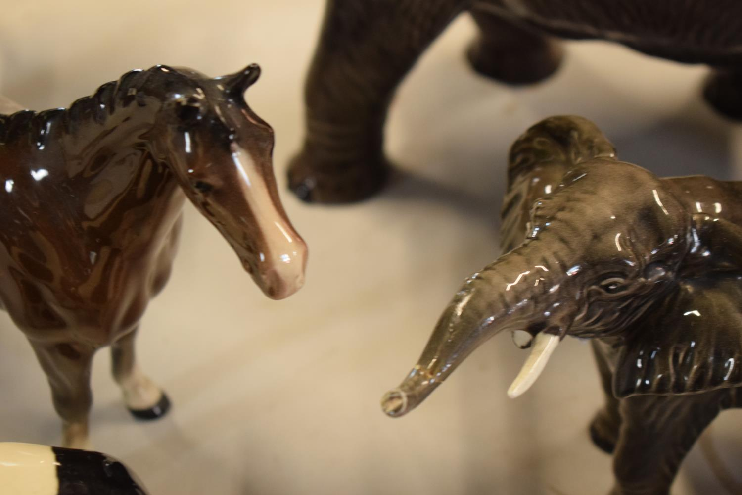 A collection of mainly Beswick animals to include elephants, a bull, birds and horses etc (all as - Image 5 of 10