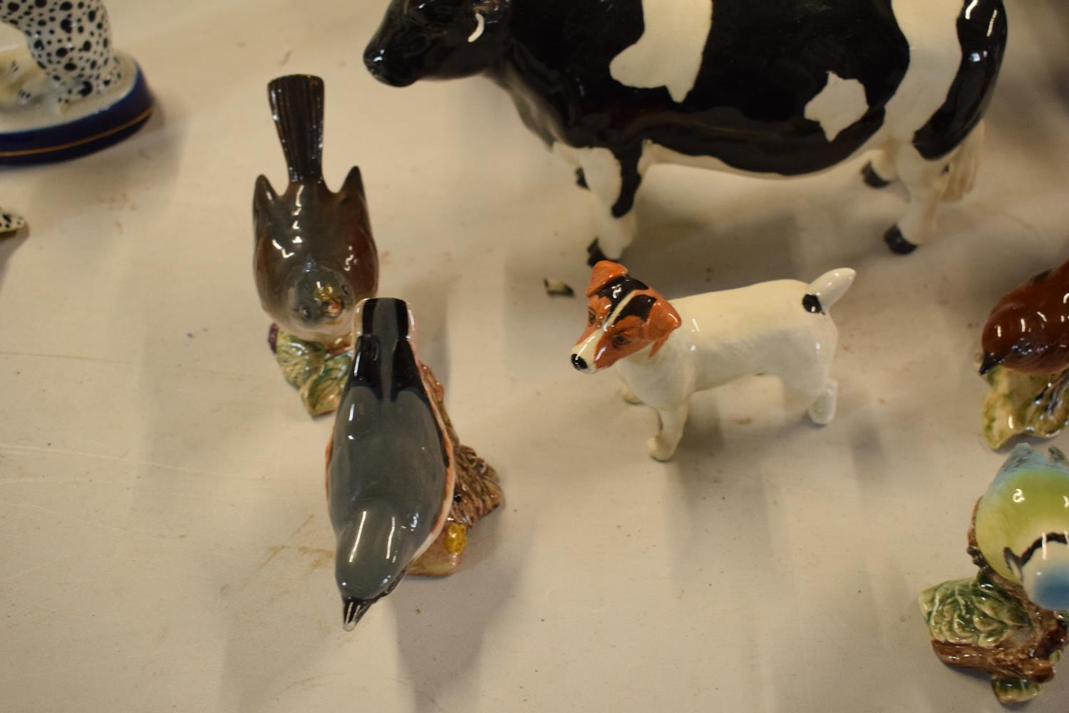 A collection of mainly Beswick animals to include elephants, a bull, birds and horses etc (all as - Image 9 of 10