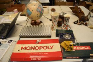A mixed collection of items to include board games such as Monopoly and Scrabble (may be