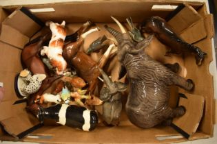 A collection of mainly Beswick animals to include elephants, a bull, birds and horses etc (all as