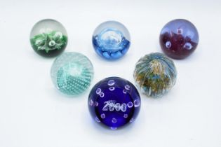 A collection of Caithness paperweights to include Moonflower, Cauldron, Moonflower, Millennium,