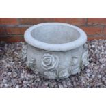 Reconstituted stone small rose planter. Made in England, these items are frost and weather proof.