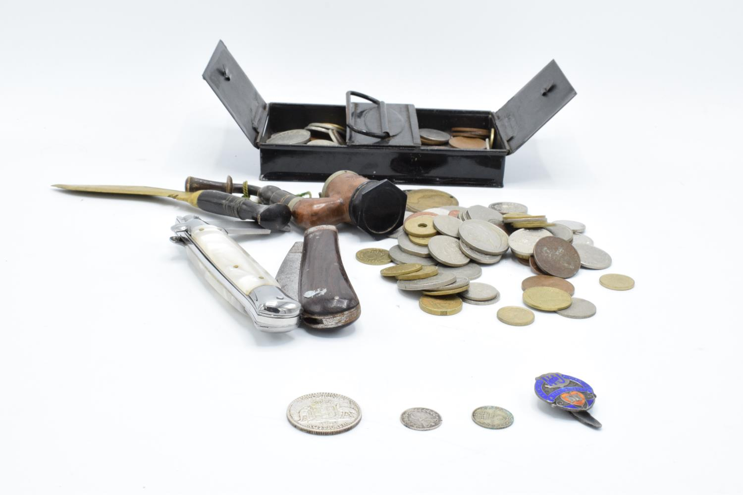 A mixed collection of items to include a hallmarked silver badge, 3 silver coins, a collection of