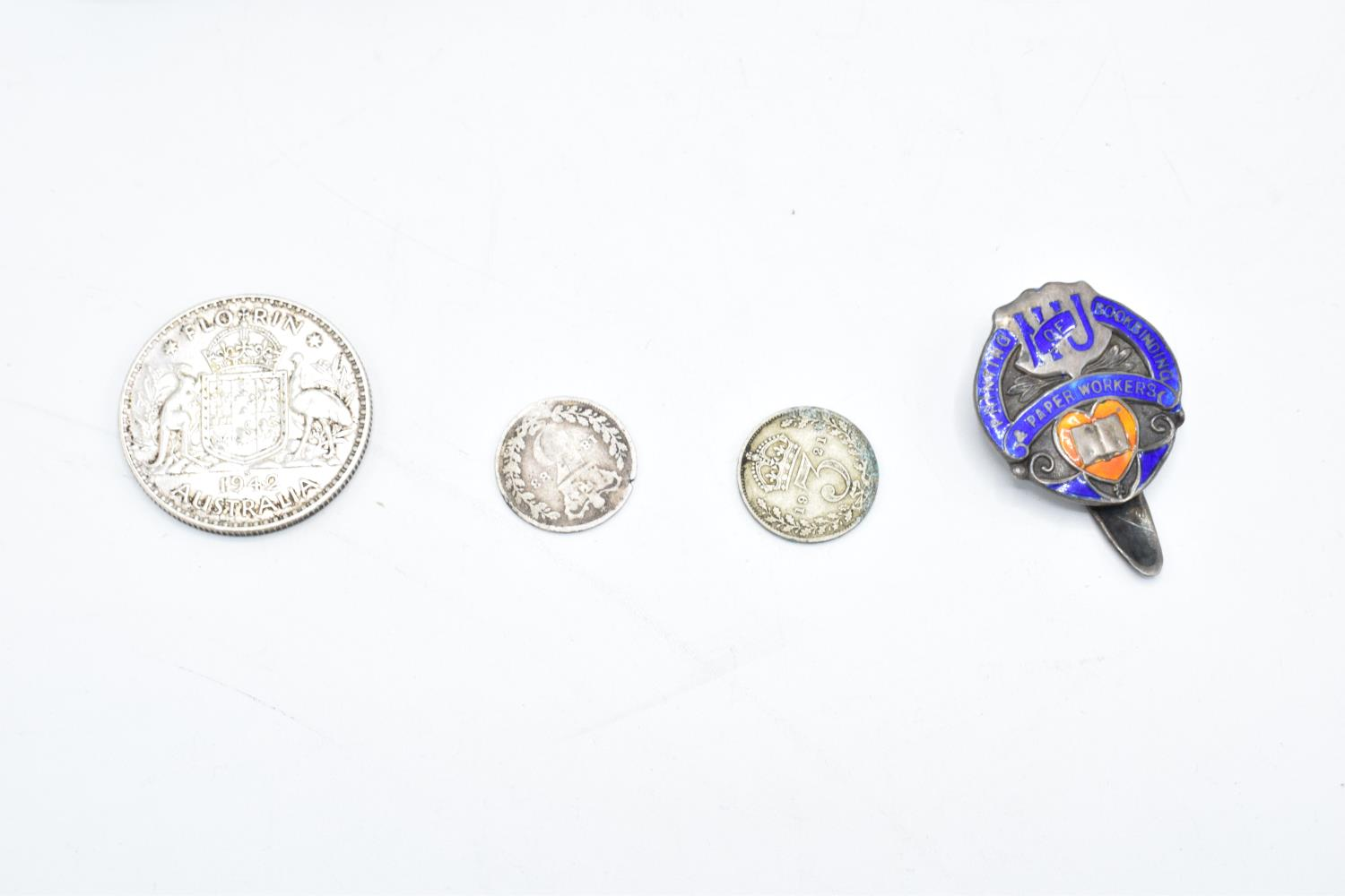 A mixed collection of items to include a hallmarked silver badge, 3 silver coins, a collection of - Image 2 of 4