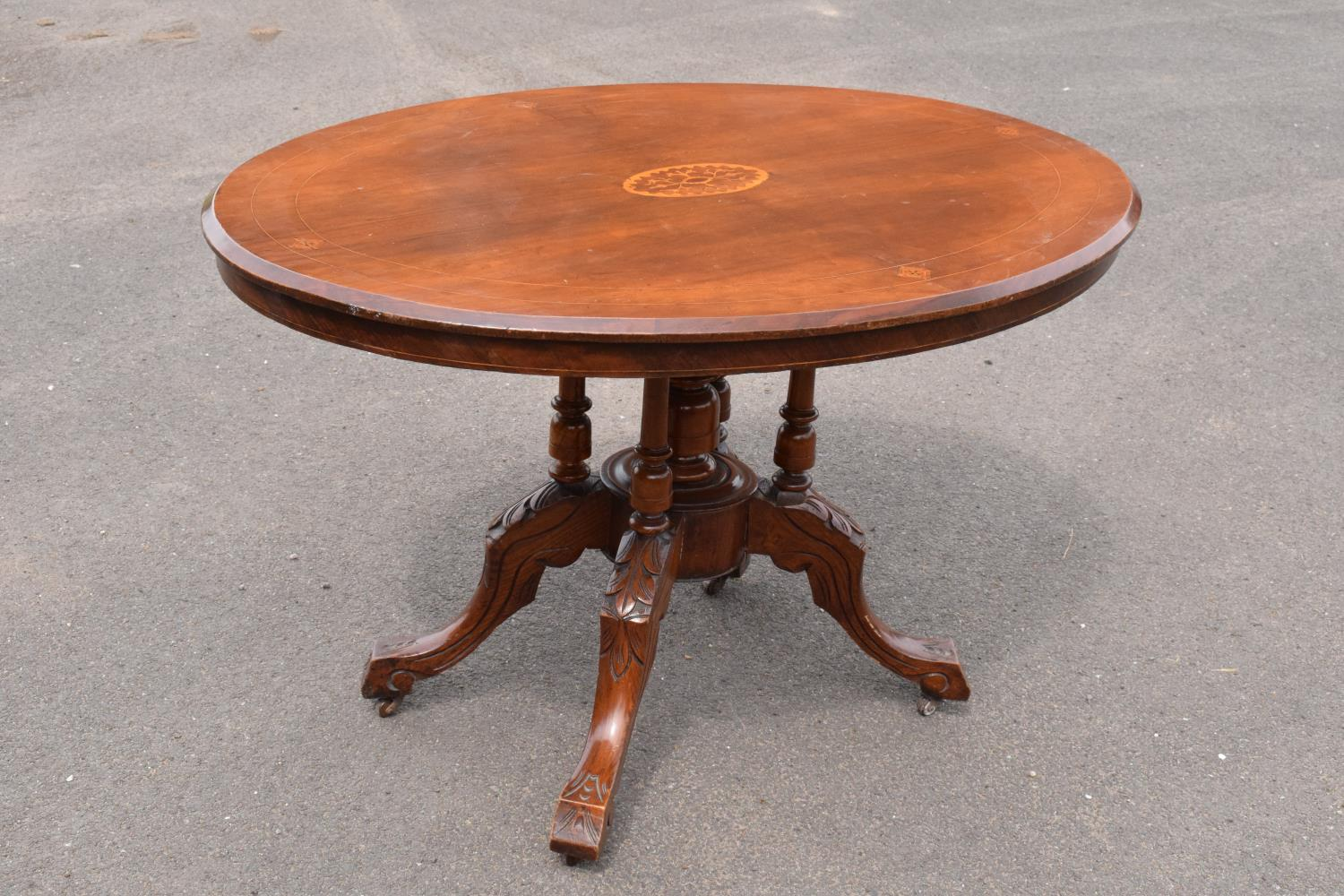 Late 19th century Victorian walnut veneered table with tilt top movement. In good condition with