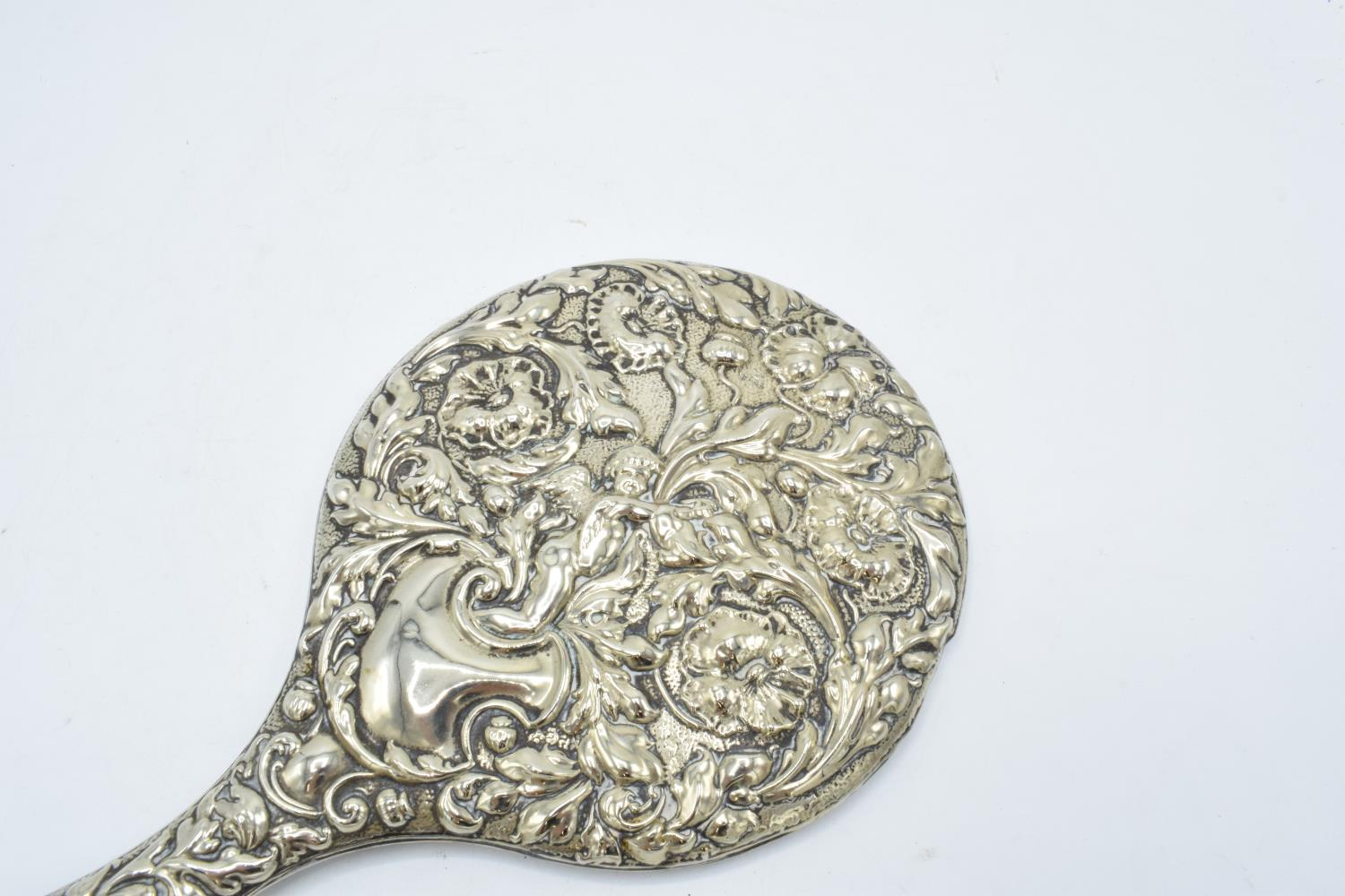 An ornate embossed hand mirror, assumed silver plate. - Image 3 of 4