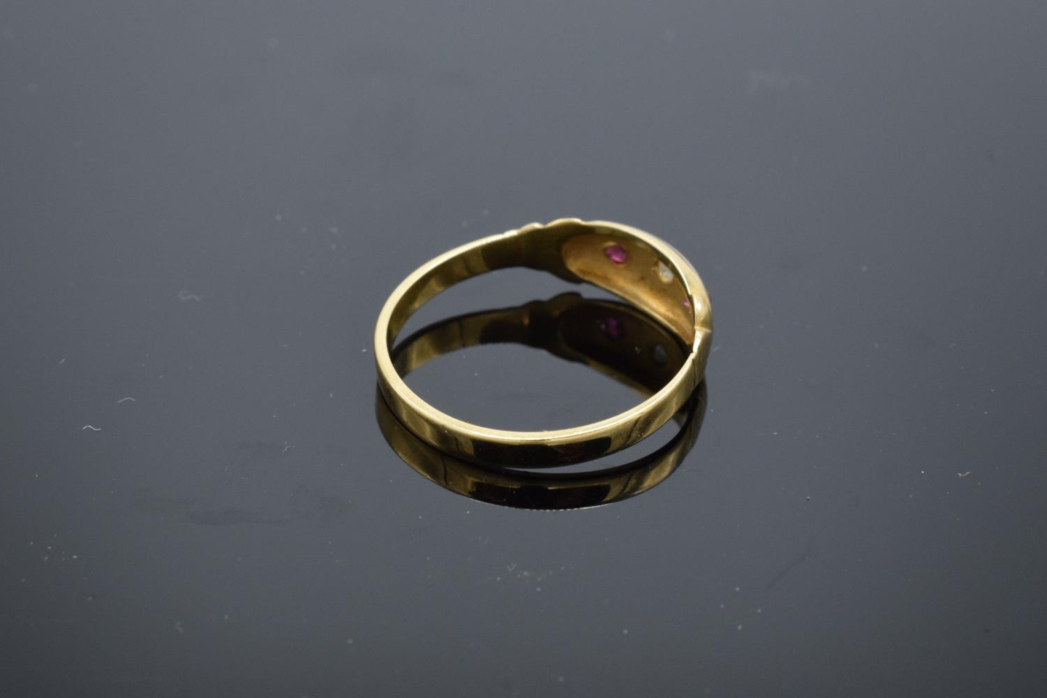 18ct gold ladies ring set with rubies and a diamond stone. UK size P/Q. Gross weight 2.2 grams. - Image 2 of 3