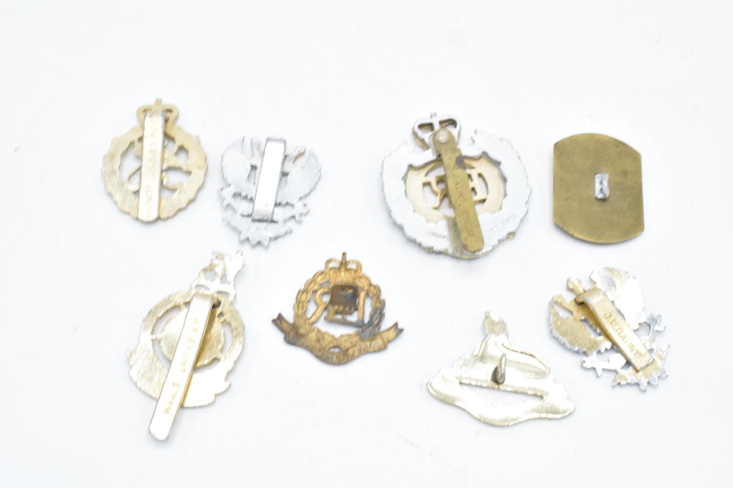 A collection of late 20th century military cap badges from Elizabeth II onwards (8). - Image 2 of 2