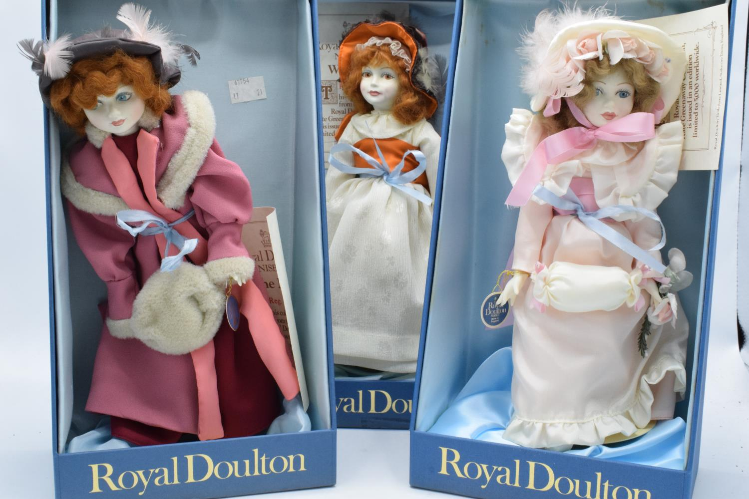A collection of boxed Royal Doulton Nisbet dolls to include Waiting, The Muff and Pink Ribbons (