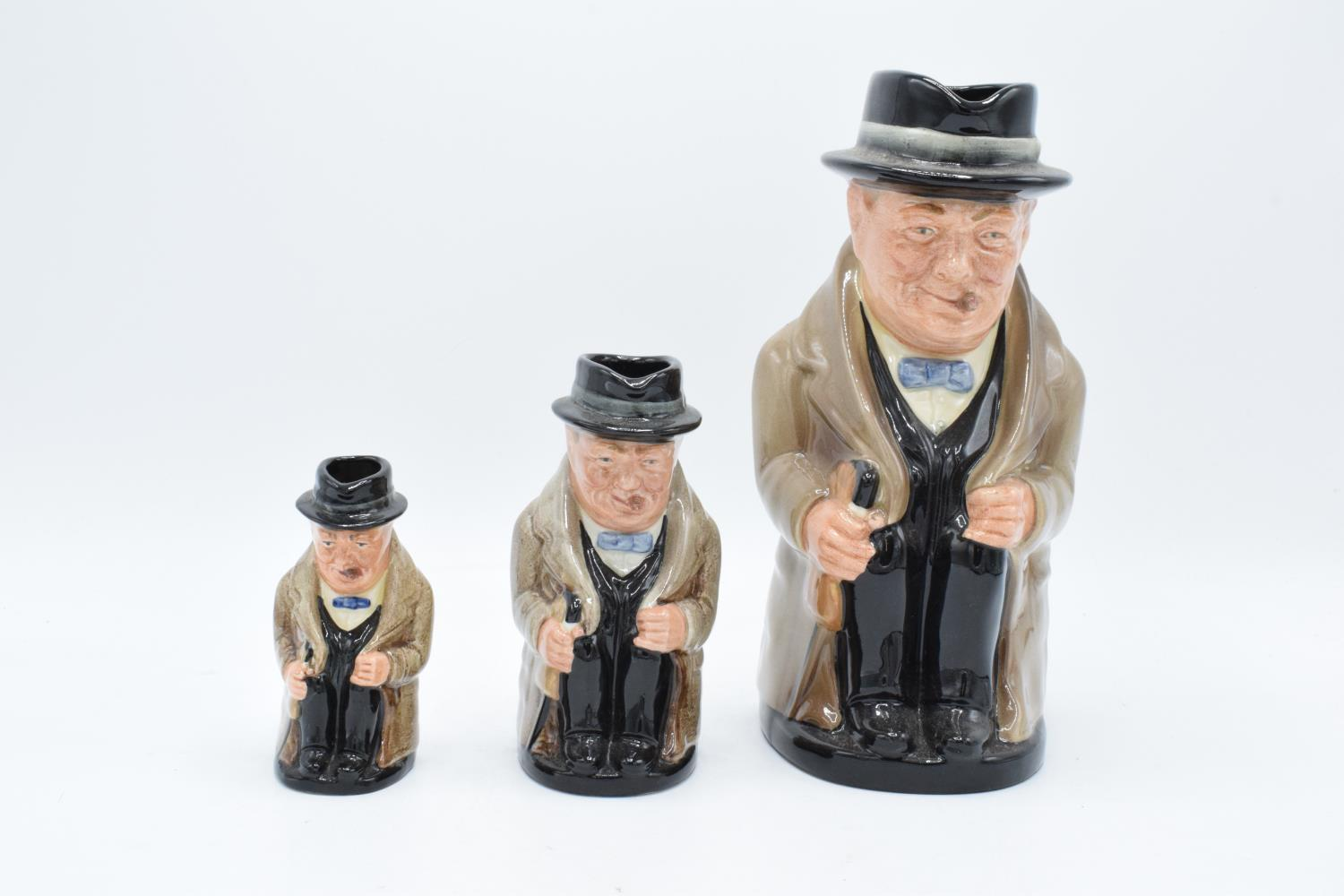 A graduated set of Royal Doulton Toby jugs of Sir Winston Churchill (3). In good condition with no