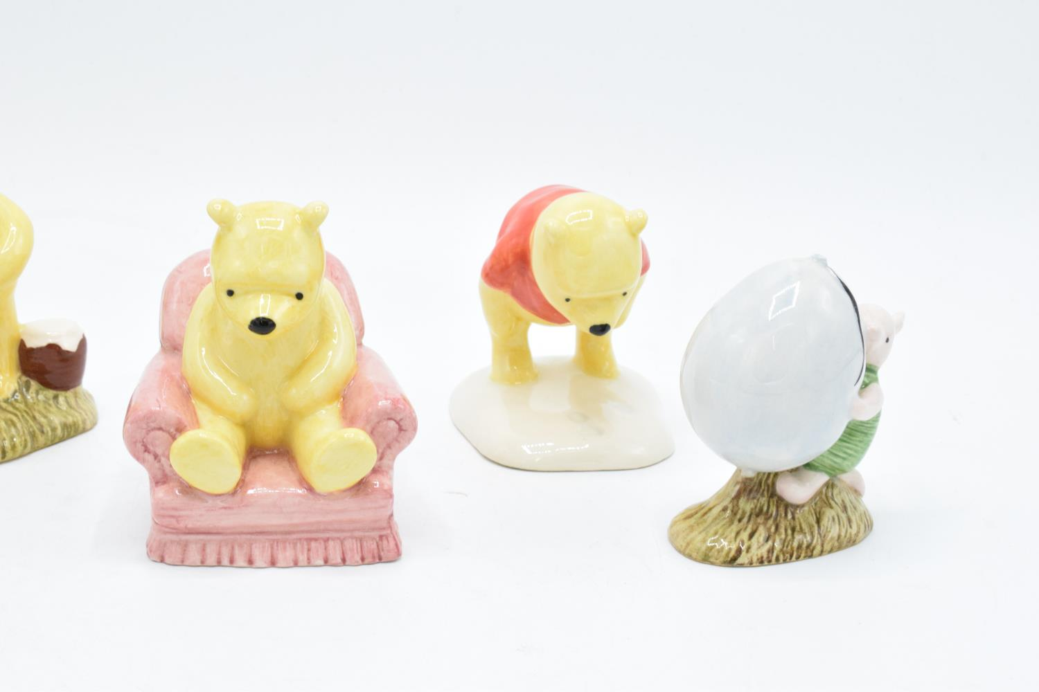 A collection of Royal Doulton Winnie the Pooh figures to include Winnie the Pooh and the paw - Image 3 of 4