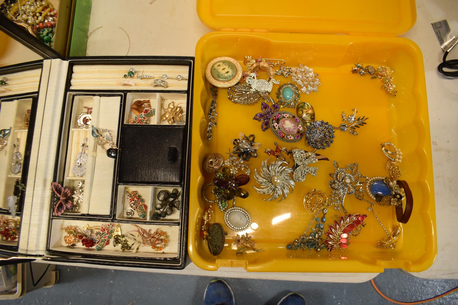 A collection of costume jewellery to include a portable jewellery box with a mirror backed lid.