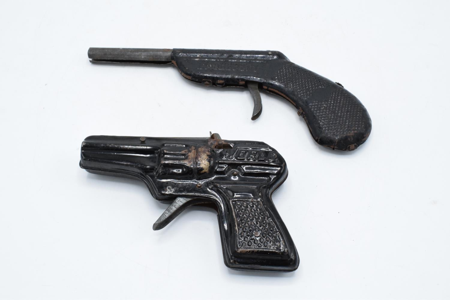A pair of vintage mid century metal cap guns 'World' and 'L'arderent' (2). Untested.