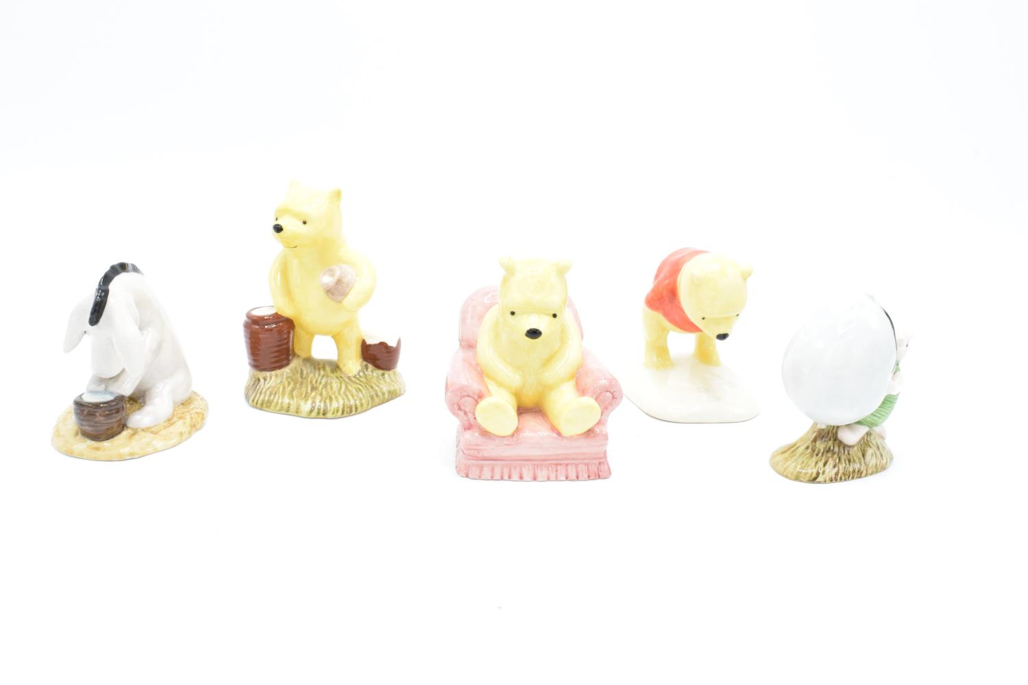 A collection of Royal Doulton Winnie the Pooh figures to include Winnie the Pooh and the paw