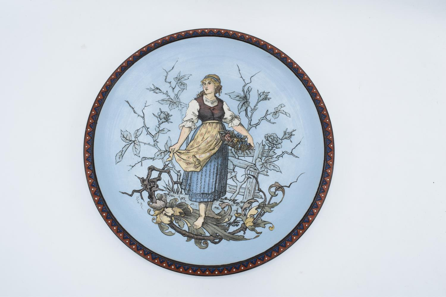 Late 19th century Mettlach (Villeroy and Boch) wall charger after C. Warth decorated with a lady