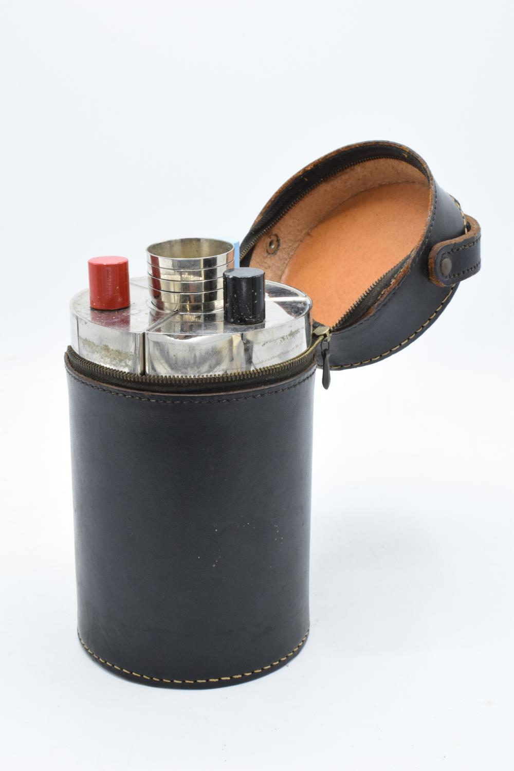 A 20th century travelling drinks set to include 3 flasks and 4 cups in a leather carry case.